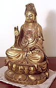 quan yin sculpture lotus position